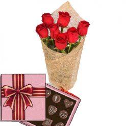 7 красных роз с конфетами фото товара